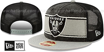 Raiders HERITAGE-BAND TRUCKER SNAPBACK Black-Grey Hat by New Era