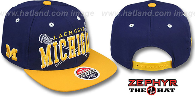 Michigan 'LACROSSE SUPER-ARCH SNAPBACK' Navy-Gold Hat by Zephyr : pictured without stickers that these products are shipped with