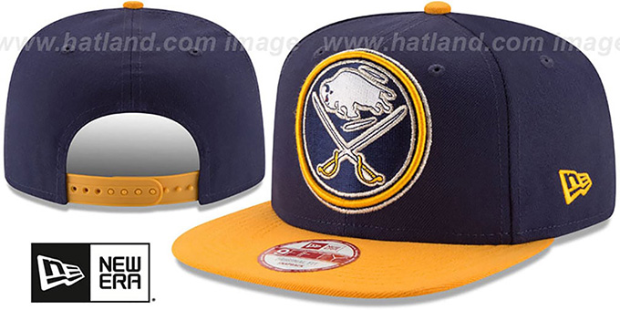 Sabres 'LOGO GRAND REDUX SNAPBACK' Navy-Gold Hat by New Era : pictured without stickers that these products are shipped with